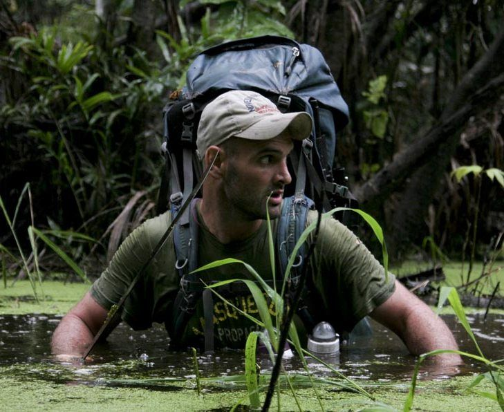 Ed Stafford wading through a river
