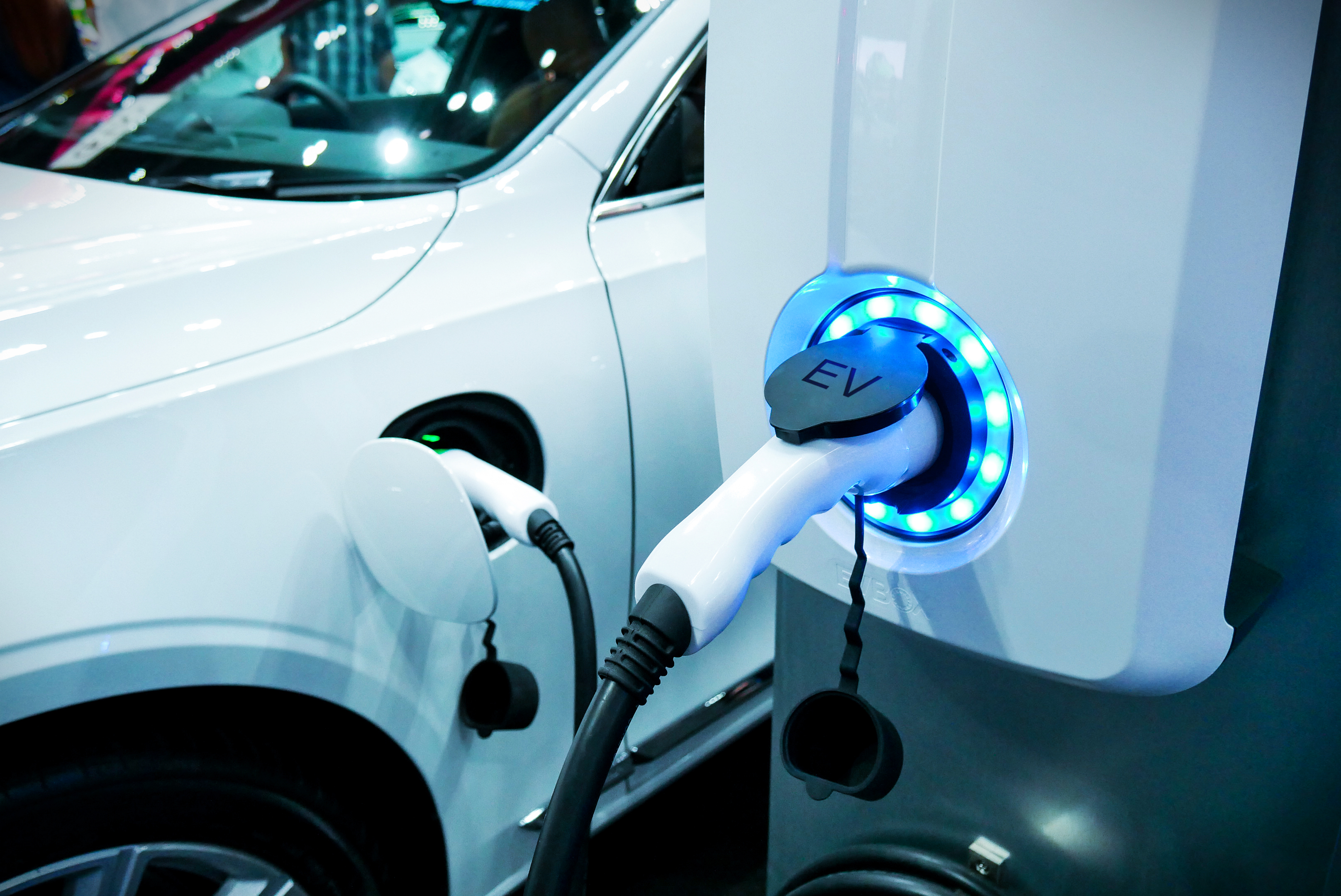 An electric car plugged into a charging station