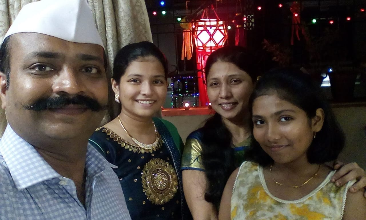 Shravani with her parents and younger sister Mansee