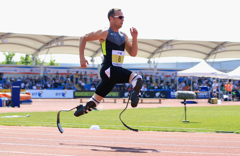 'Blade Runner' Oscar Pistorius of South Africa runs in the men's 200-meter event at the Paralympic World Cup. Photo Credit: Michael Steele/Getty Images