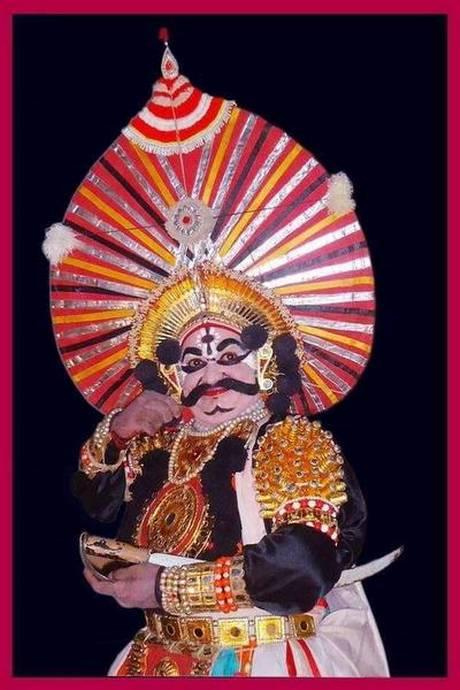 An artist wearing a Yakshagana Pagade