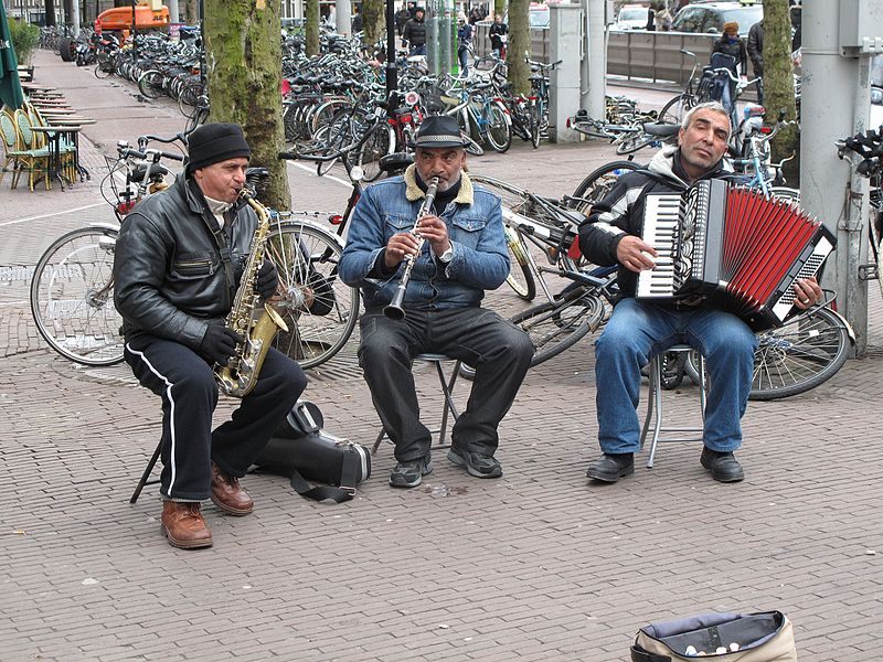 Musicians playing instruments together. Image source: Wikimedia Commons