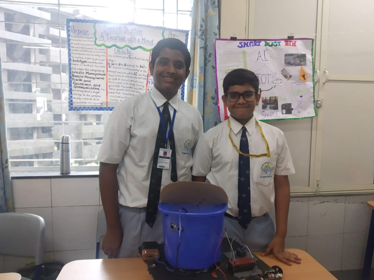 """Venkat along with his friend made a """"smart dustbin"""" using a motor taken out of a sewing machine. The dustbin can sense when someone approaches it and opens up itself!"""
